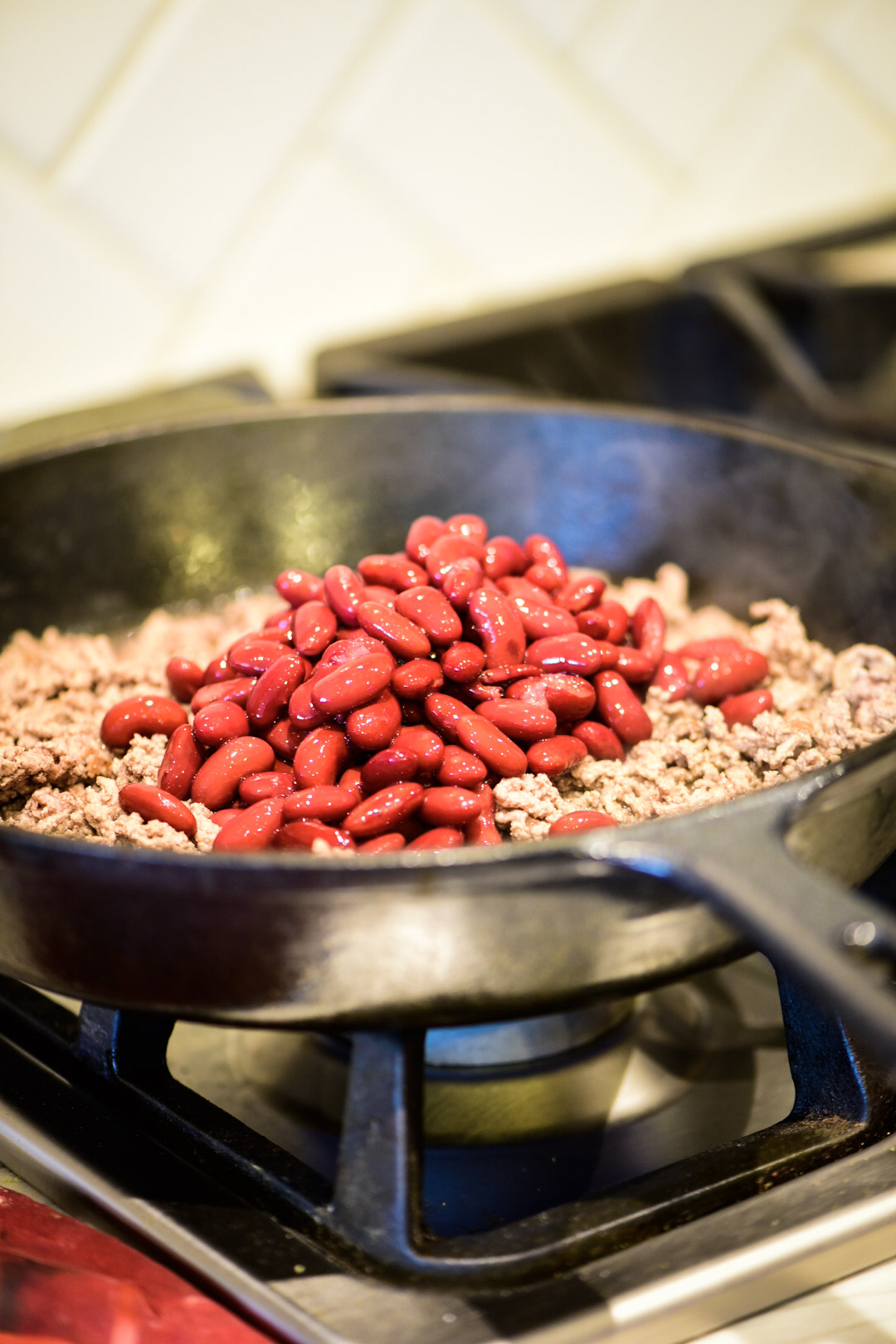 Adding beans to ground beef mixture