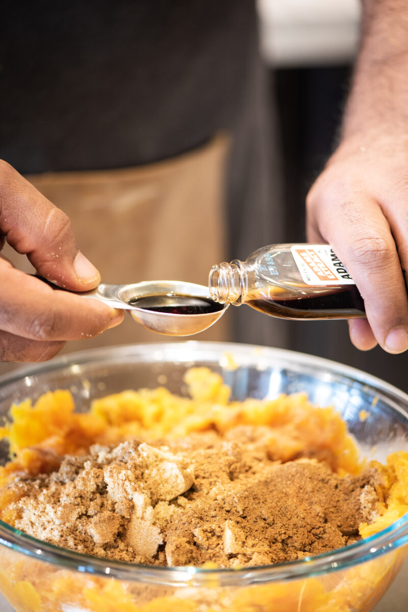 Adding vanilla extract to sweet potato pie filling