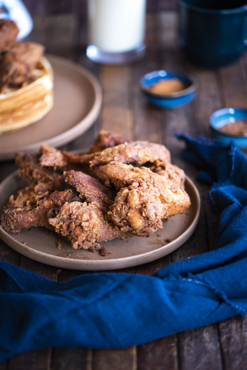 fried eggnog chicken wings on a plate