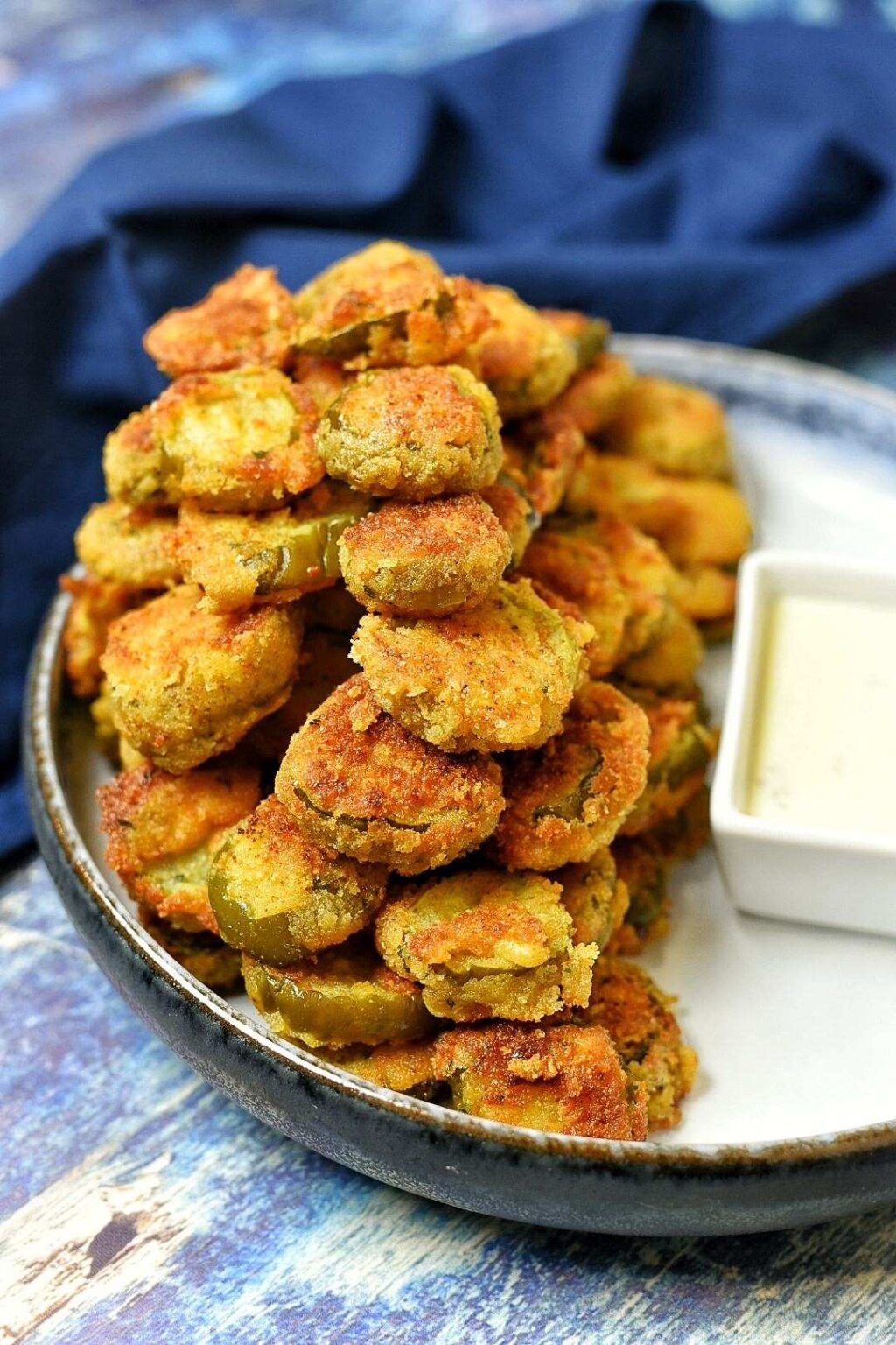 Creole Fried Pickles with a side of -ranch dressing for dipping