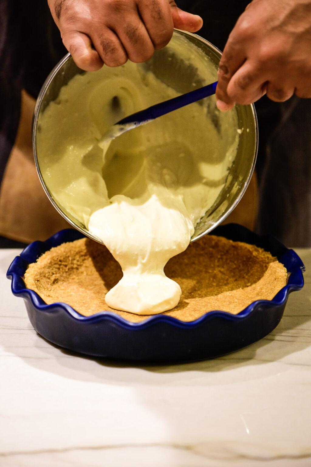 Pouring lemon pie filling into pie dish