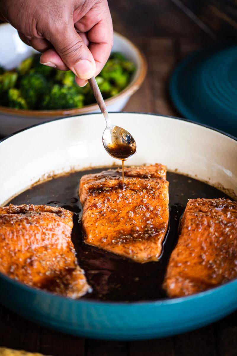 pouring extra glaze on finished fish