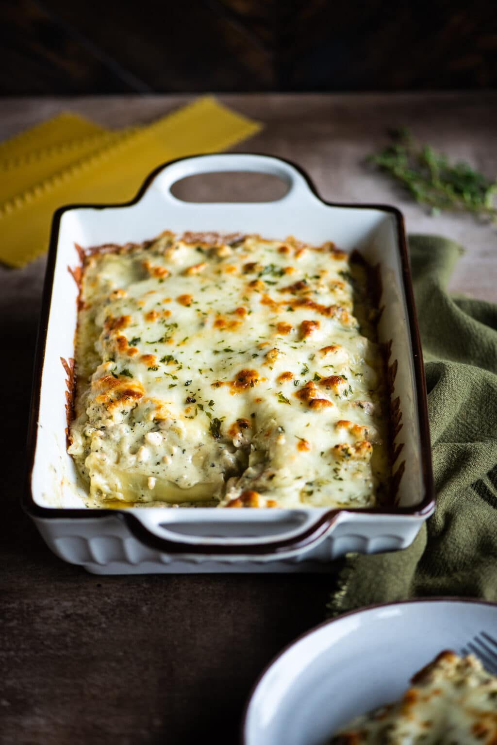 White lasagna rolls with creamy basil pesto sauce