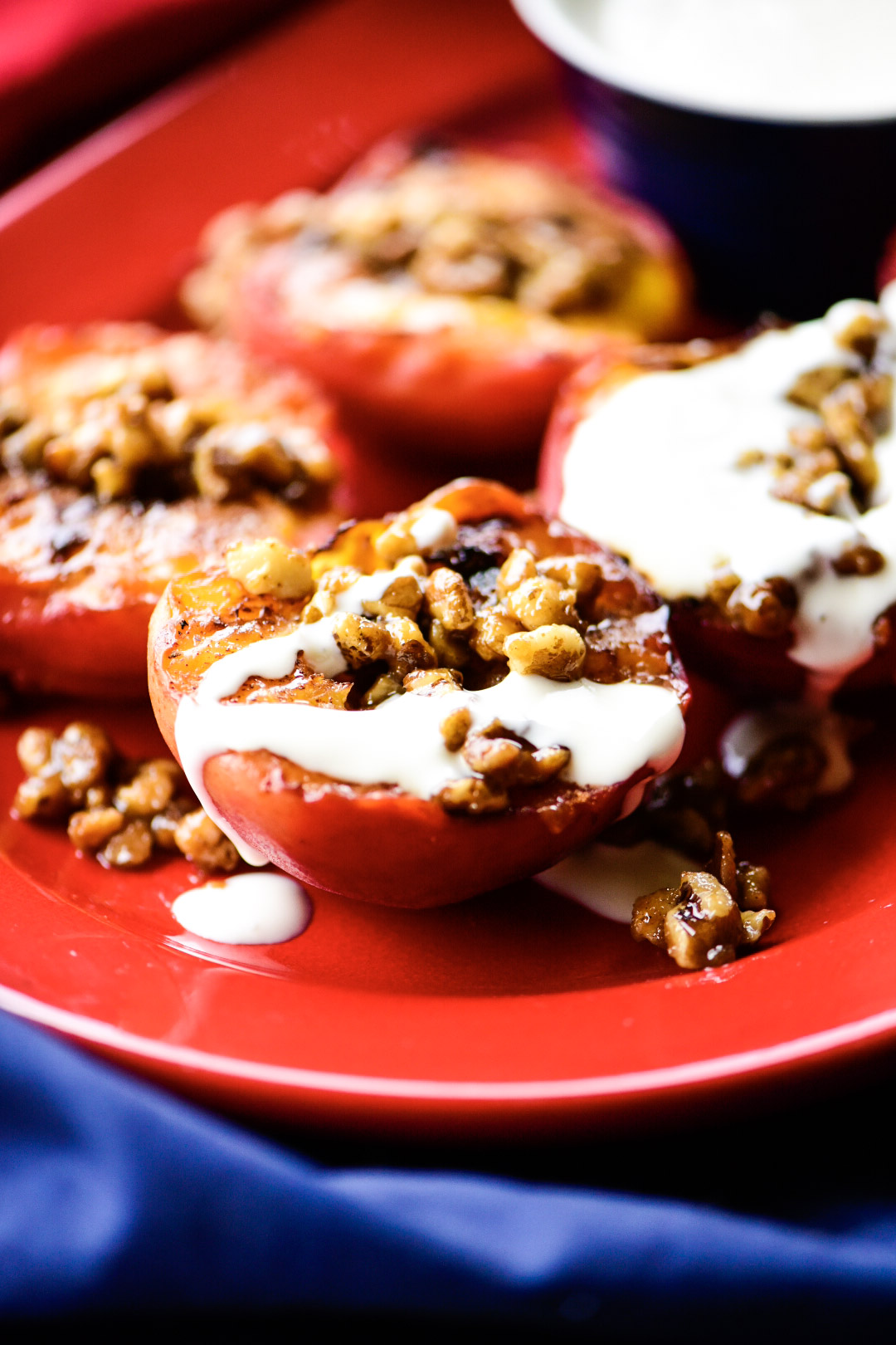 grilled peaches with candies walnuts and cream