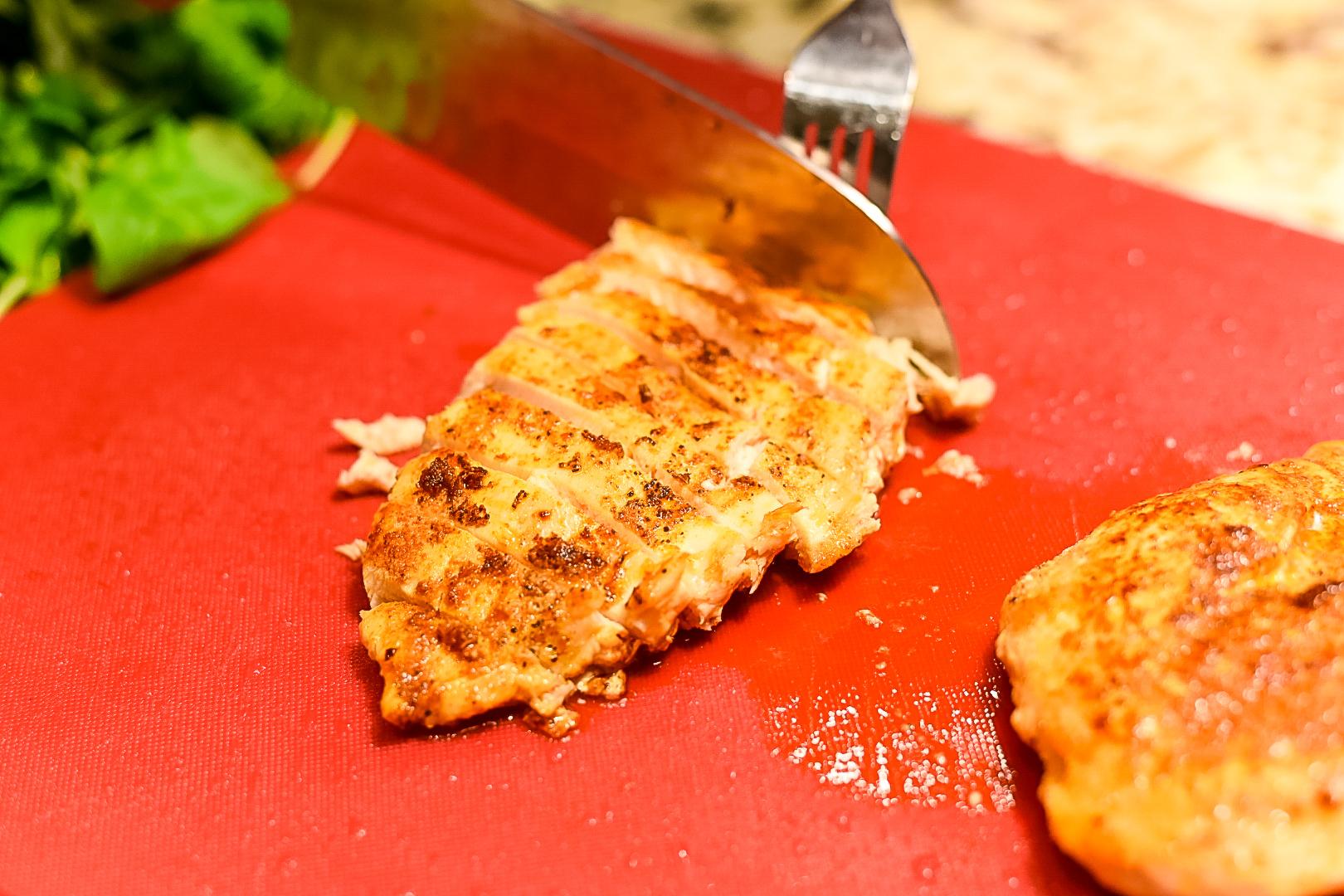 Slicing grilled chicken