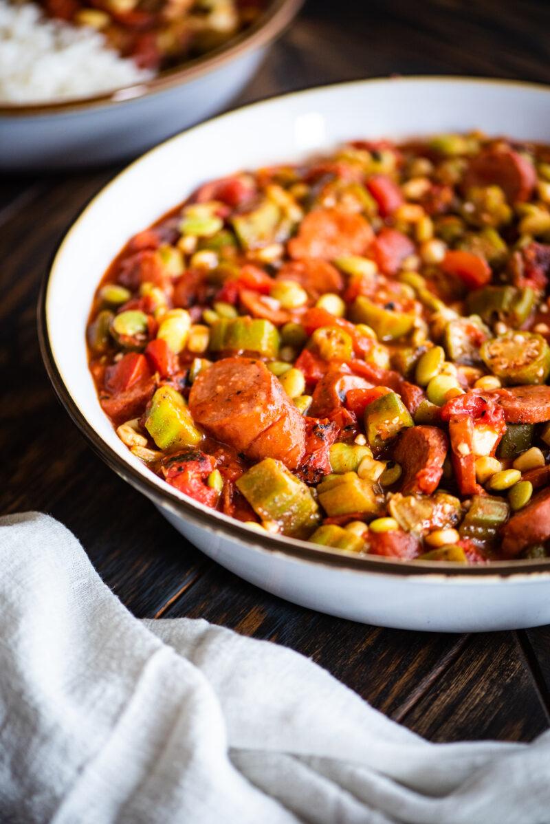 close up shot on chicken sausage in stewed okra recipe