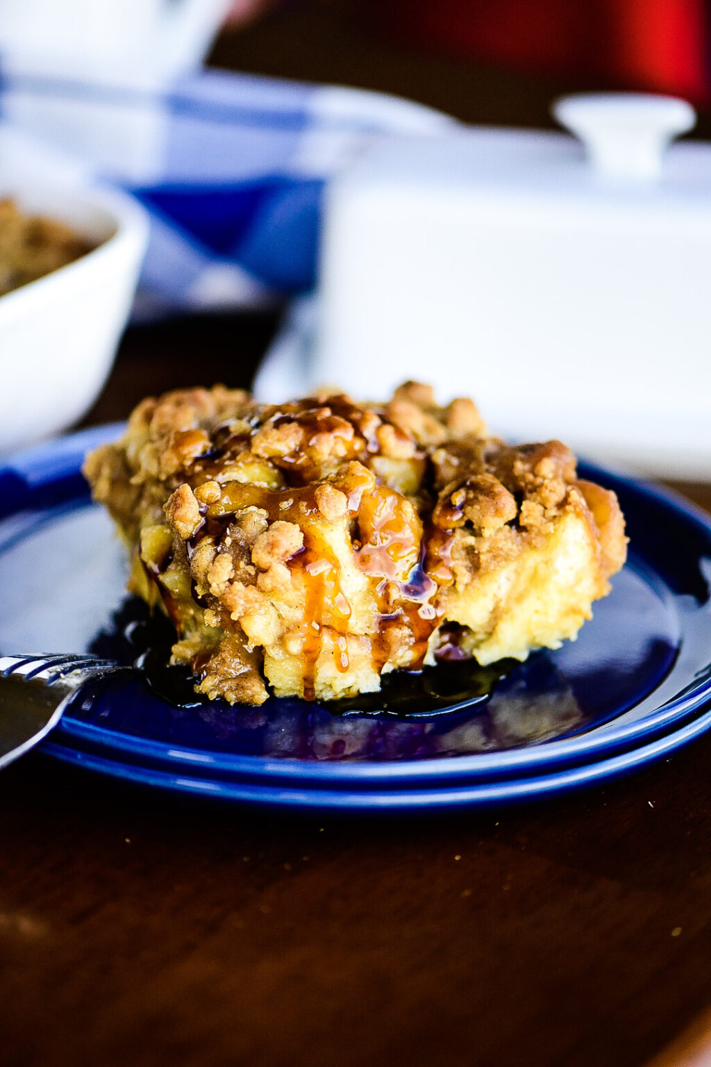Bananas Foster French Toast Casserole covered in syrup.