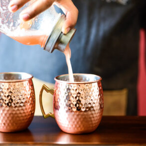 Pouring Watermelon Moscow Mule Cocktail in mule cup