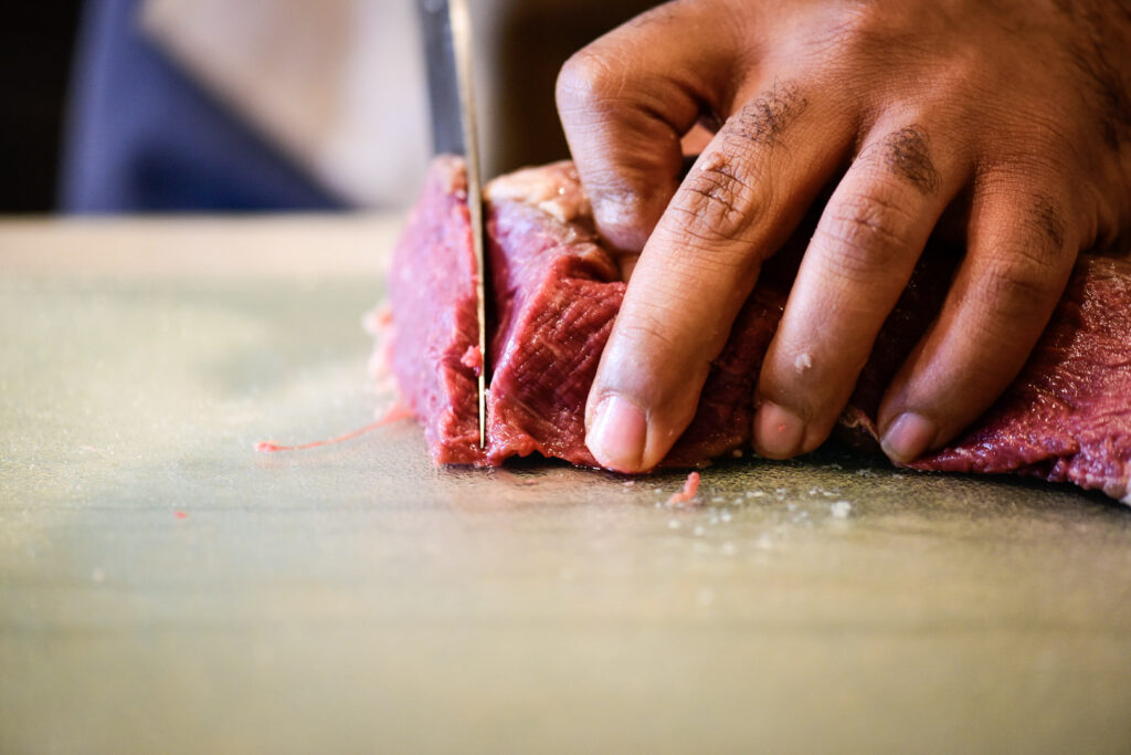 Slicing beef tenderloin into thin slices