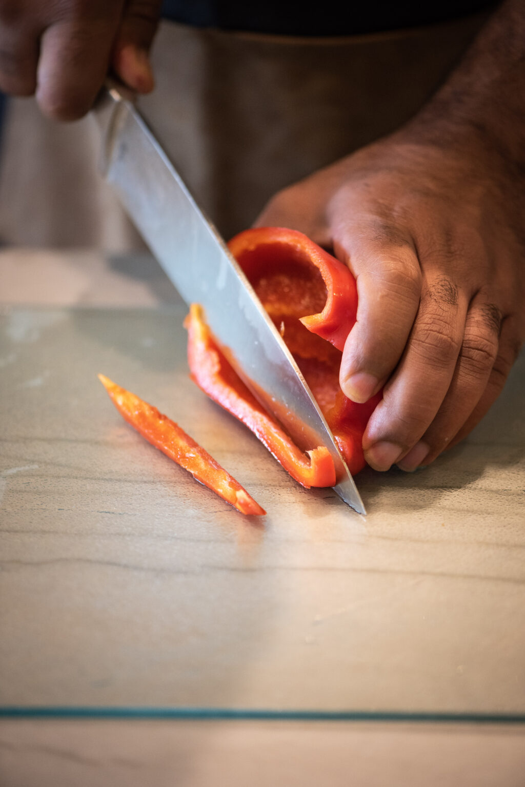 Slicing red bell peppers