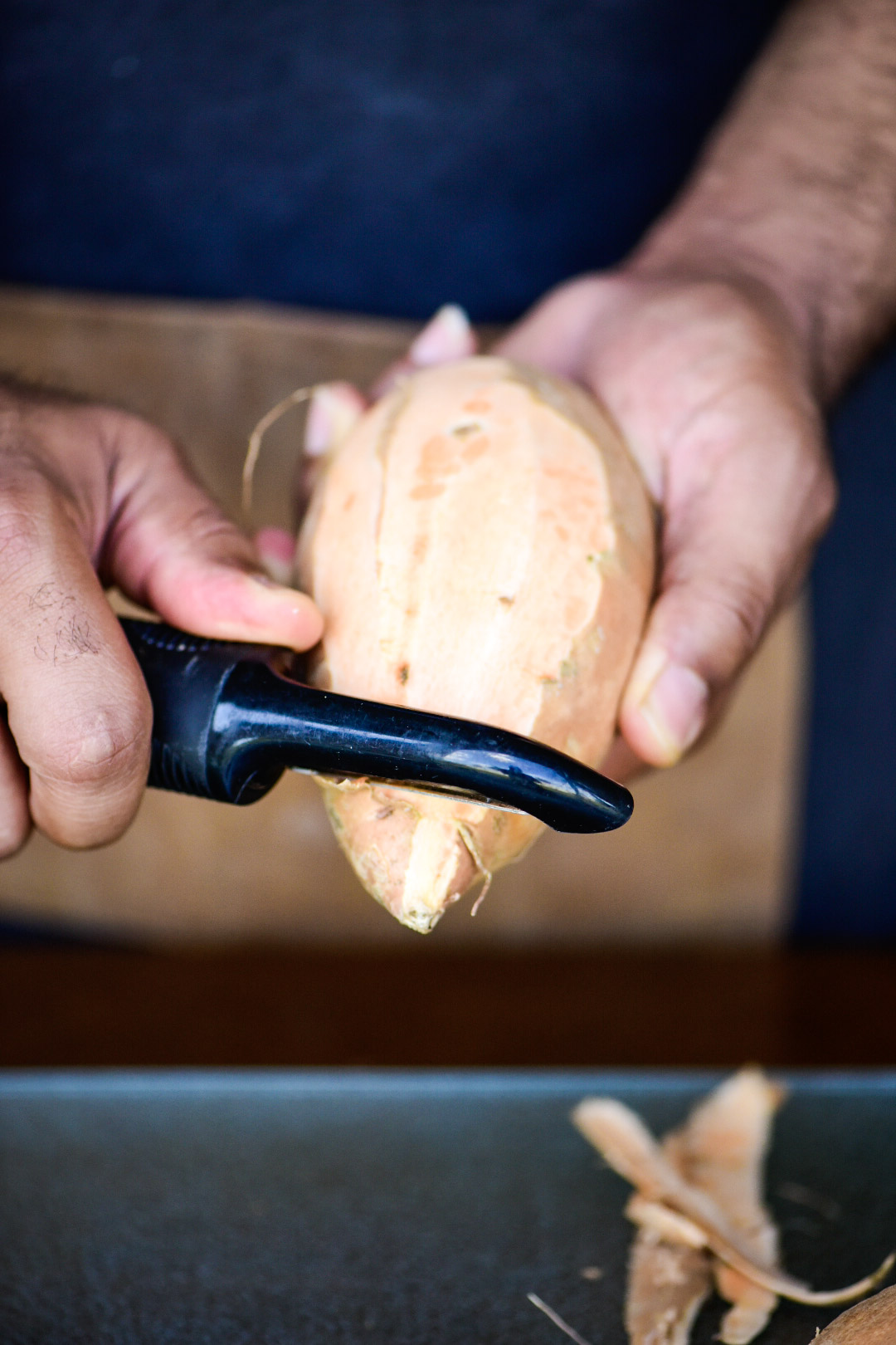 peeling and removing skin from sweet potatoes