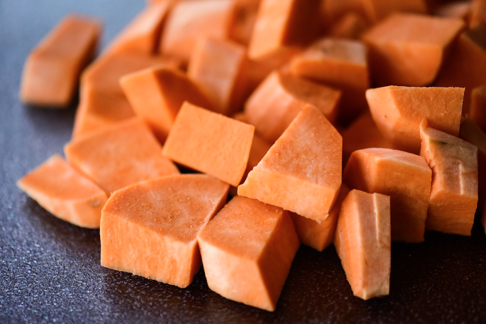 raw and cut sweet potatoes