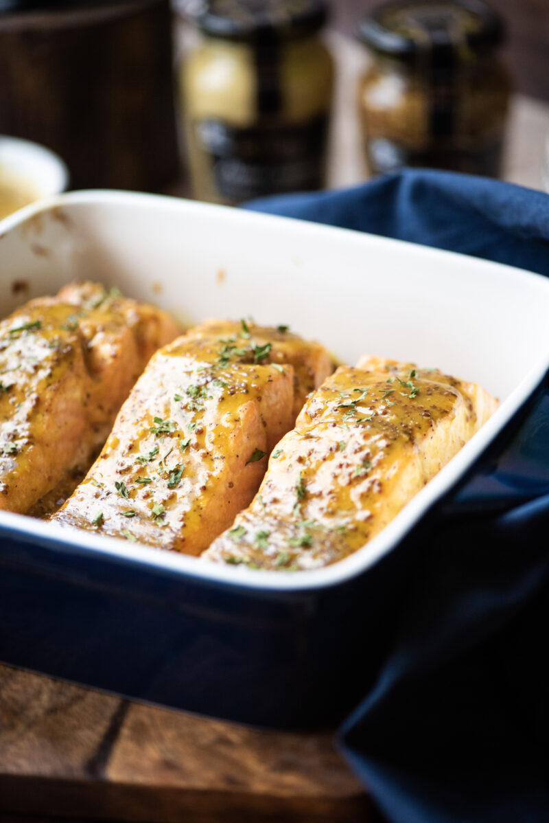 Close up of Honey-mustard glazed salmon is baking dish