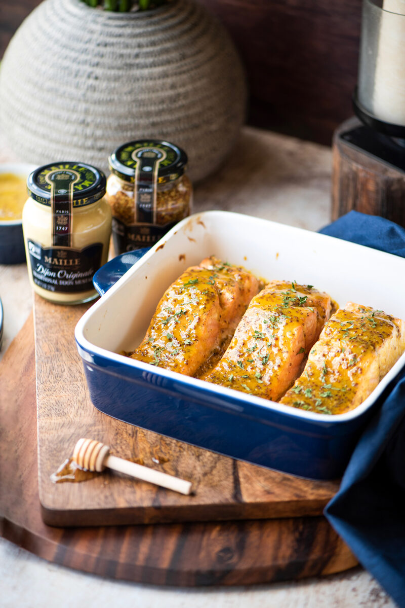 Honey-mustard glazed salmon is baking dish