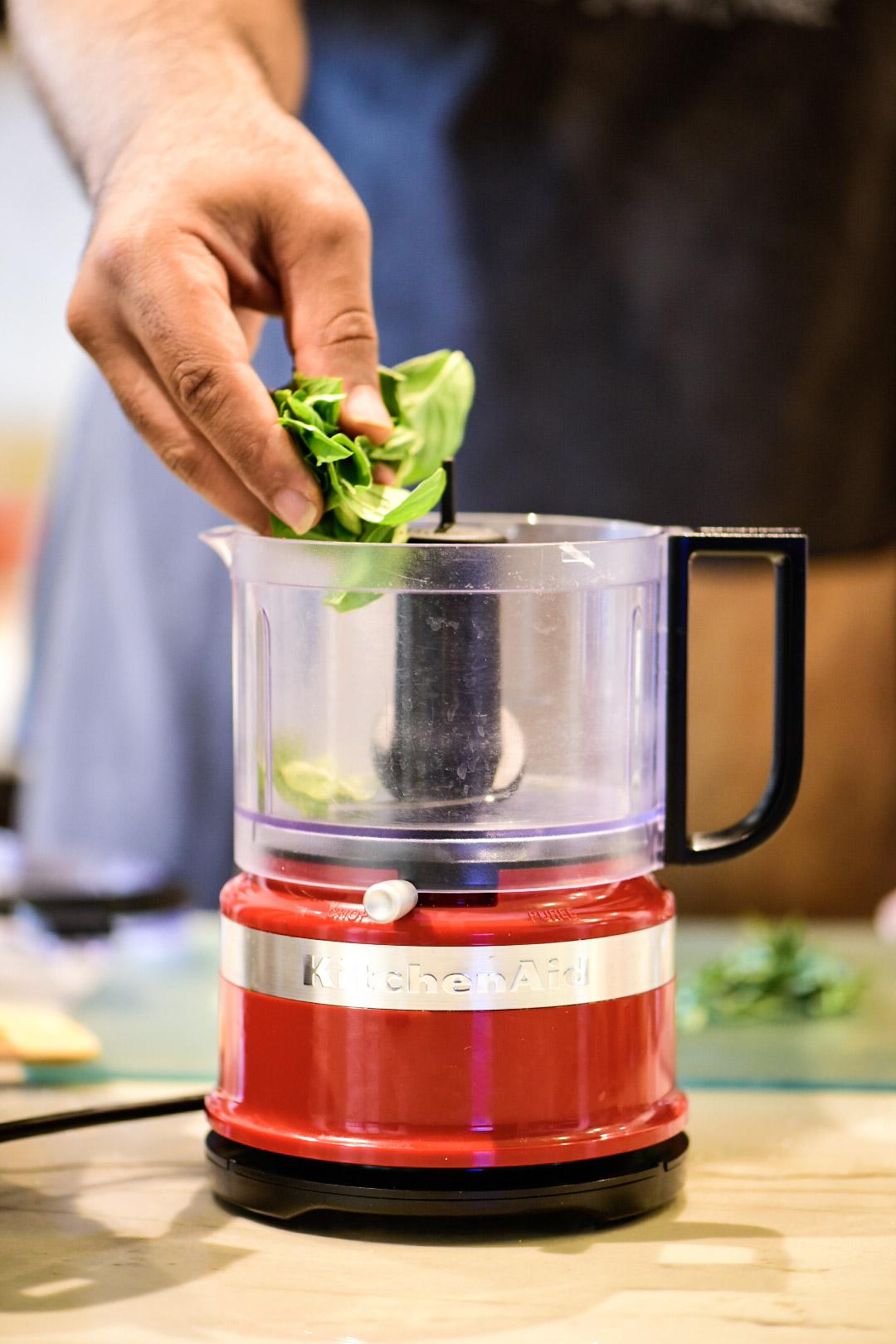 Chopping herbs for beef ragu recipe
