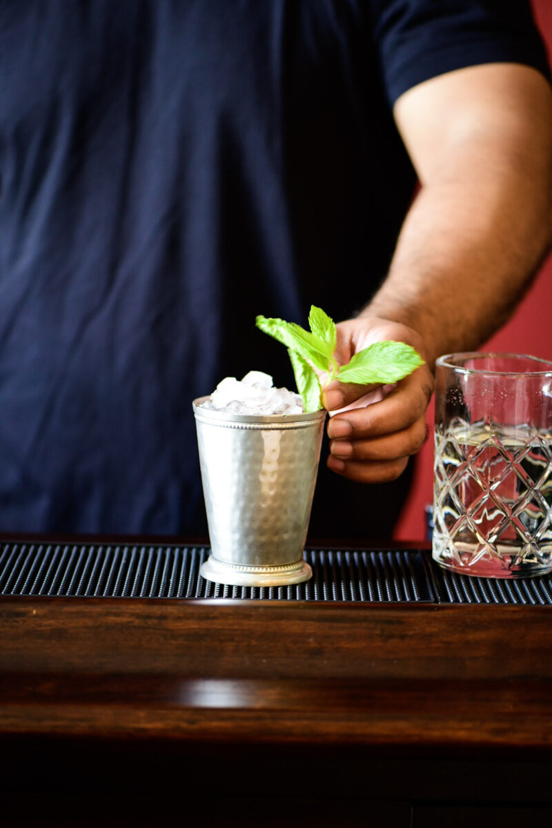 Adding fresh mint leaves as a garnish