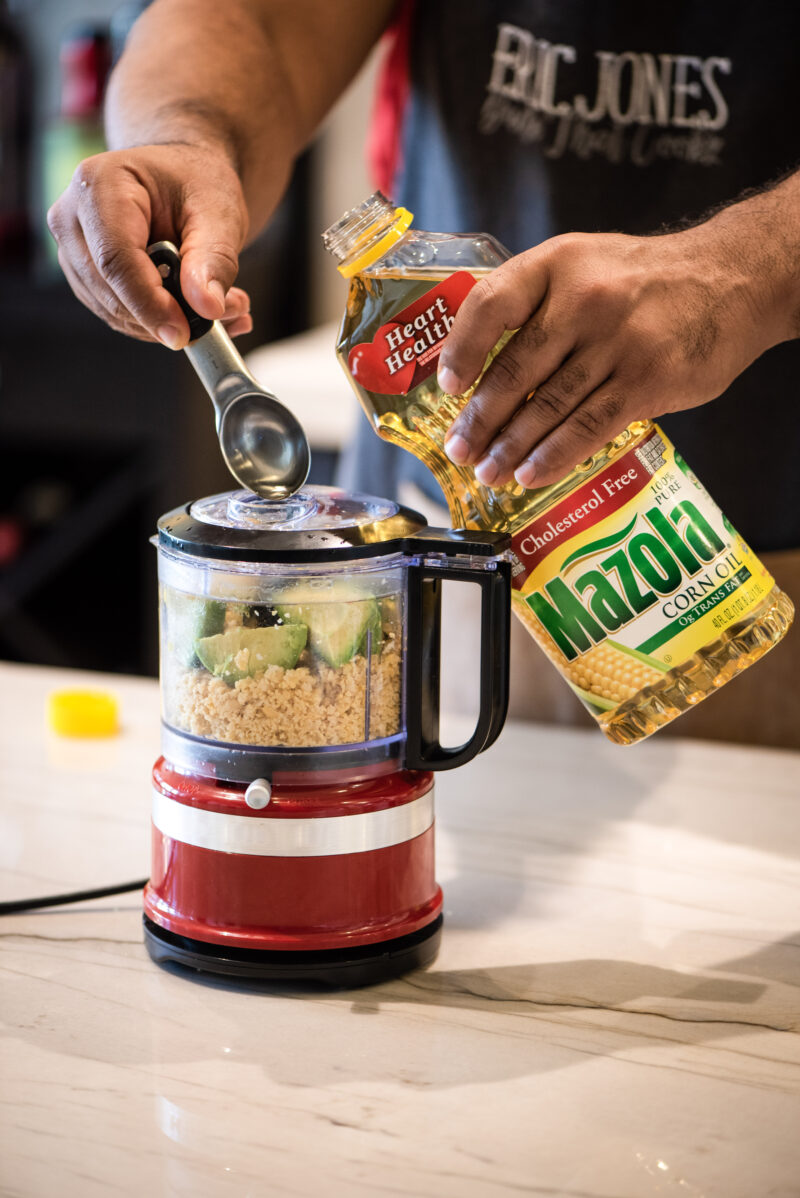 Adding Mazola Corn Oil to food processor
