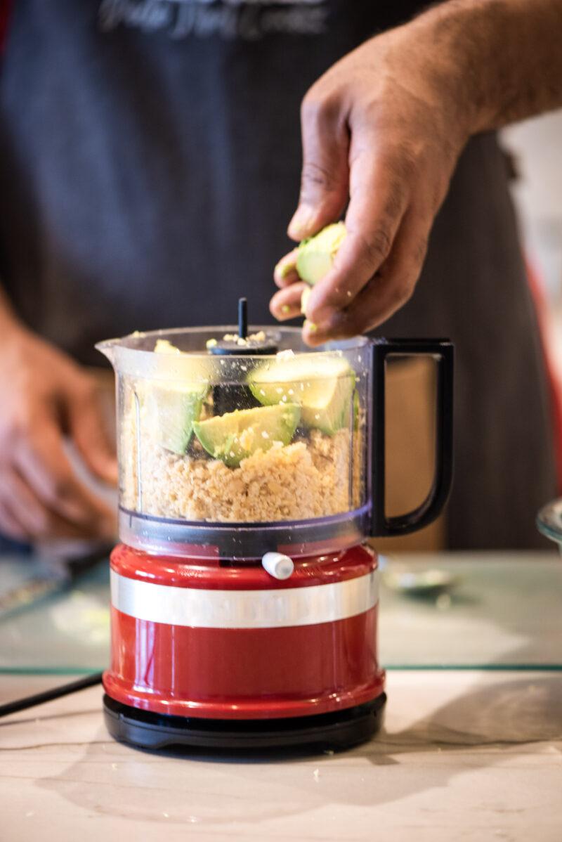 Adding avocados to the food processor