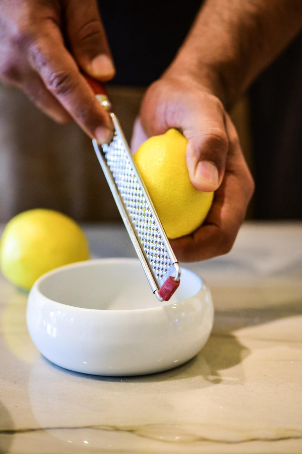 Zesting lemons for the cake