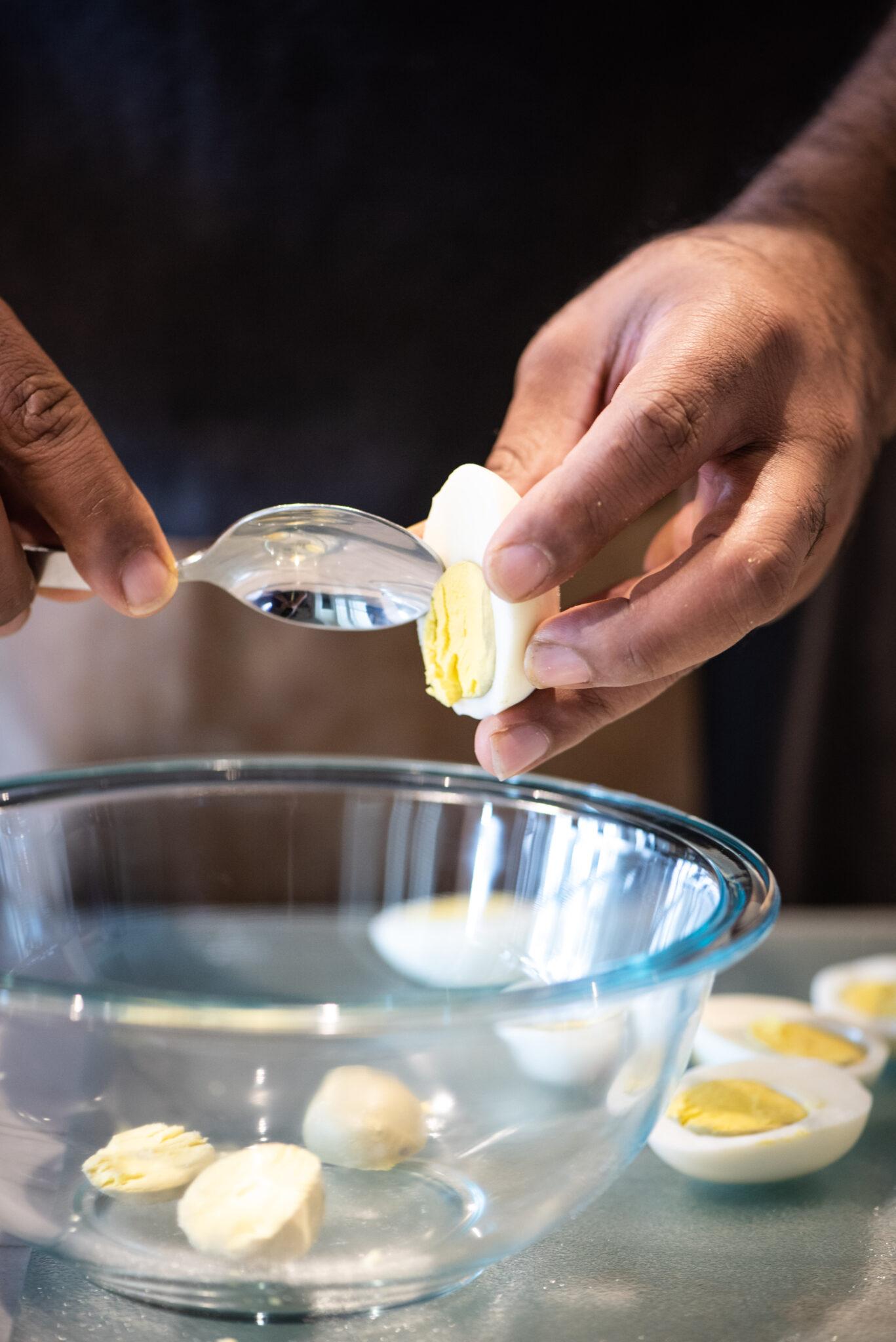 Removing yolk from hard boiled eggs