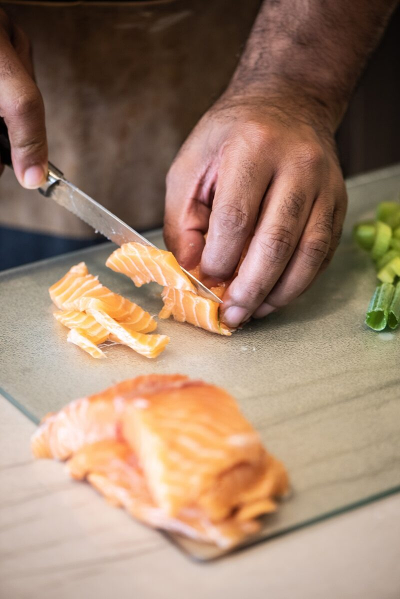 Cutting fresh salmon for salmon croquettes
