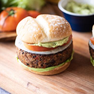 Black Bean burger with lettuce, tomato, and avocado cream sauce.