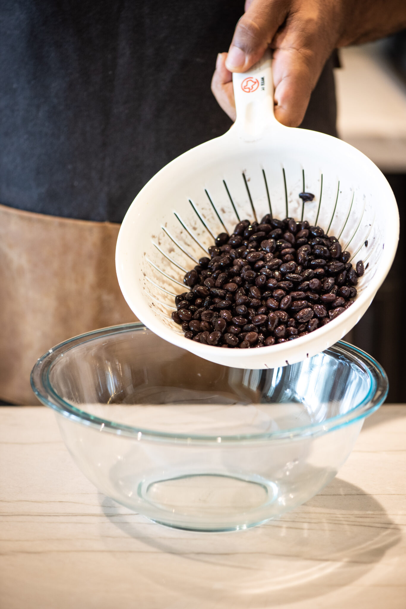 Draining canned black beans