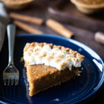 Single slice of sweet potato pie with toasted marshmallows