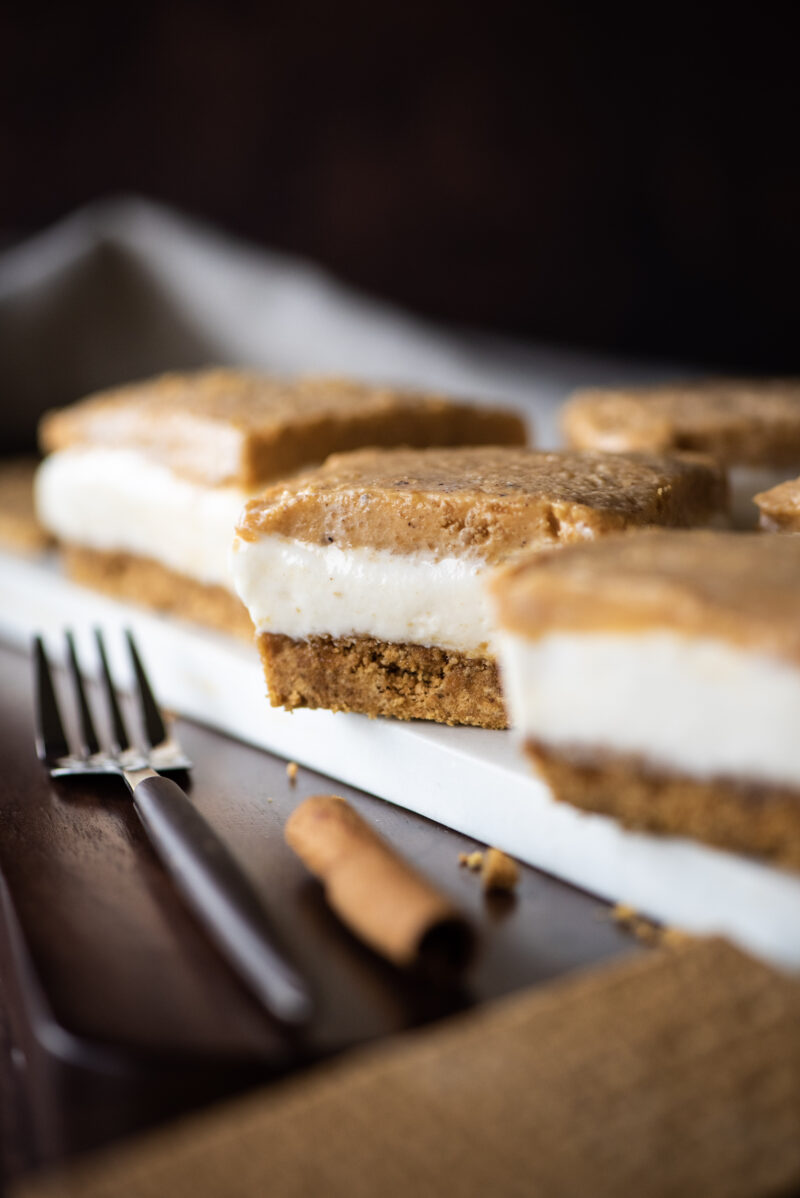 Focused shot of a single sweet potato cheesecake bar.