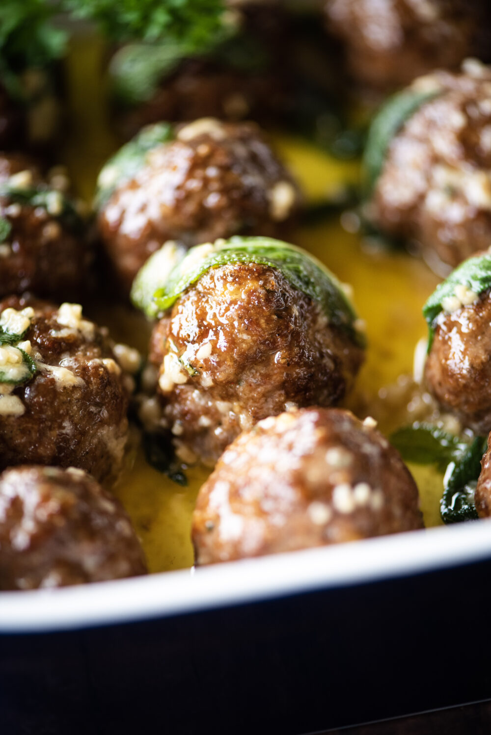 Single meatballs with sage leave on top