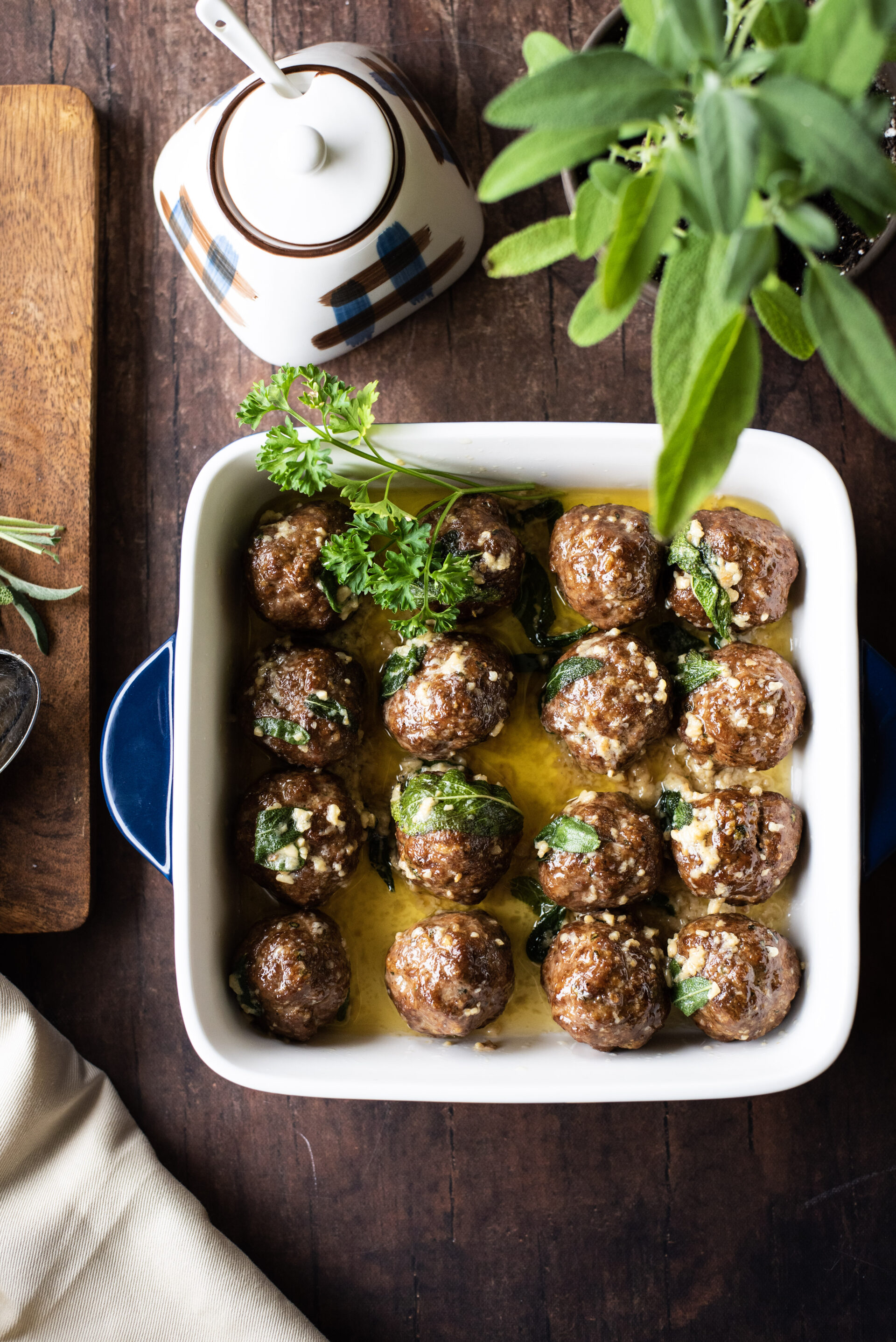 Meatballs in a sage brown butter sauce with fresh sage