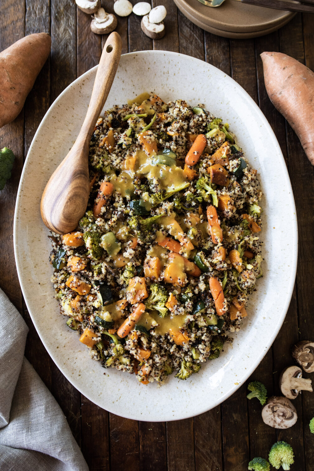 overhead shot of large platter of quinoa and roasted veggies