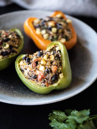 three quinoa stuffed bell peppers