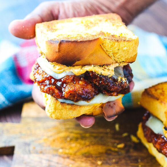 Holding Honey BBQ Chicken Strip Sandwich in hand