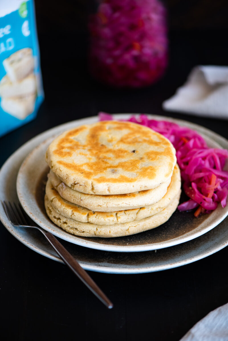 a stack of four pupusas