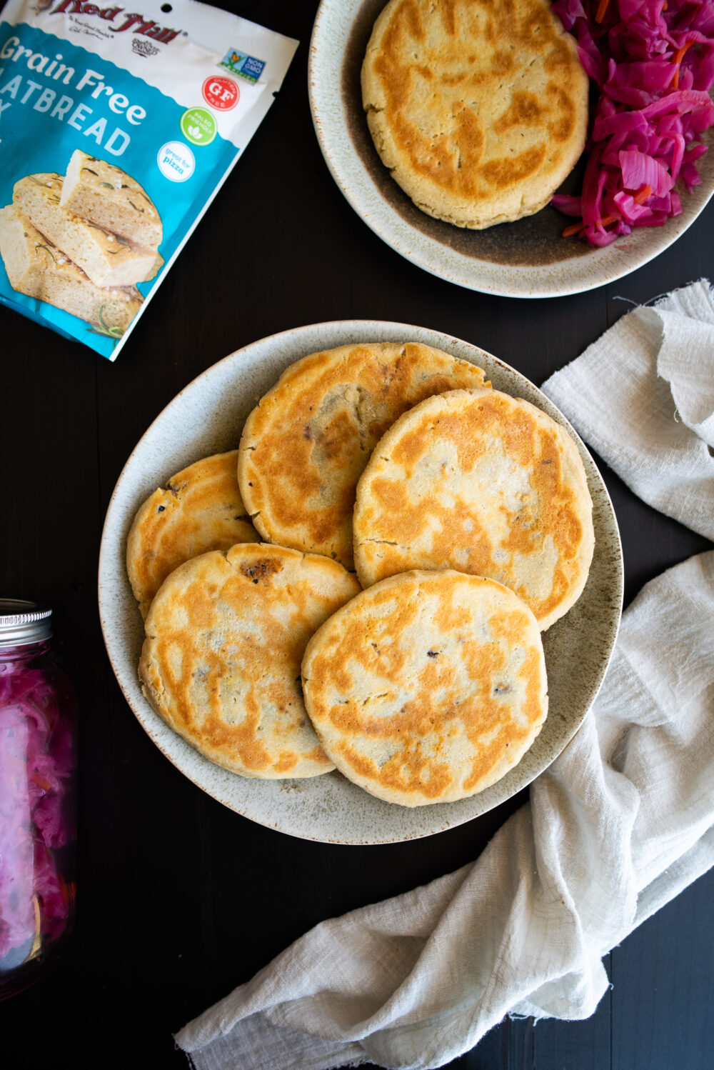 a full plate of pupusas ready to serve