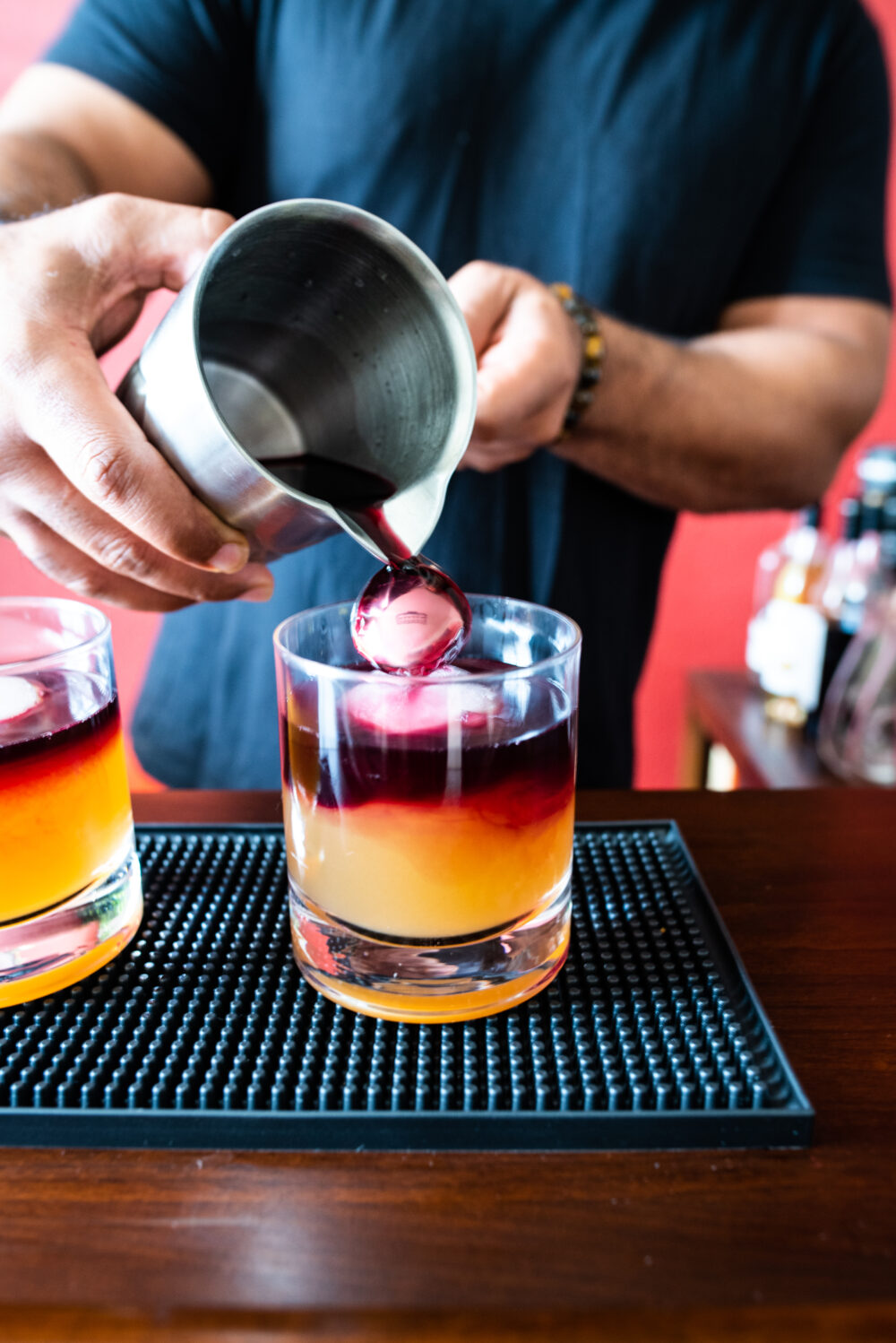 pouring red wine on back of bar spoon