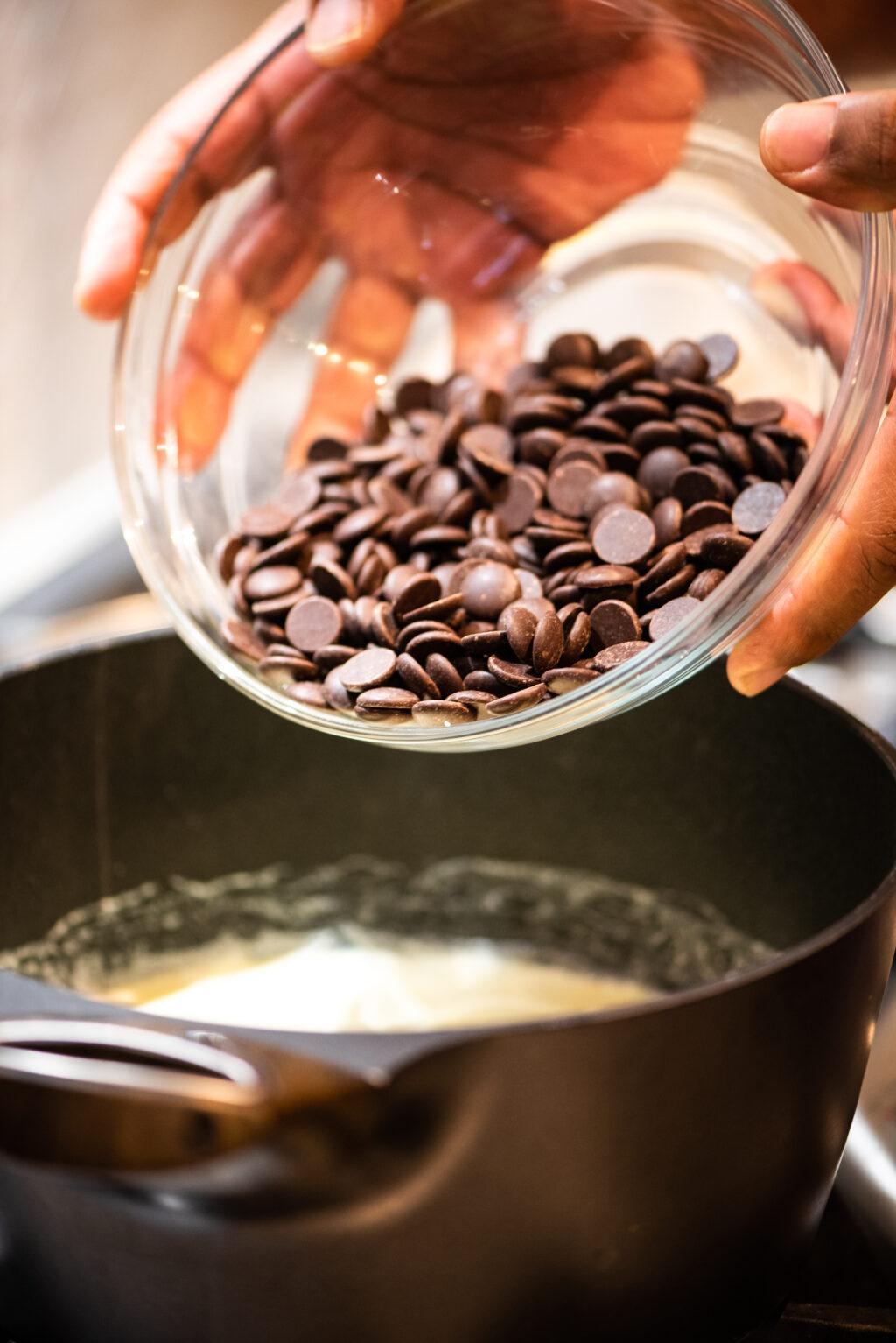 adding chocolate chips to heavy cream