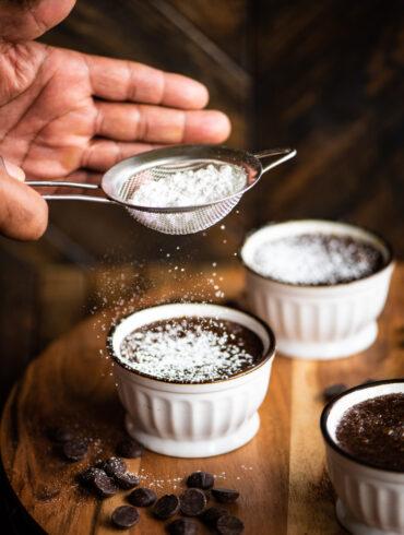 sprinkling powdered sugar on top of custard