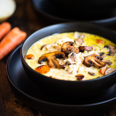 Two bowls of creamy chicken and rice soup