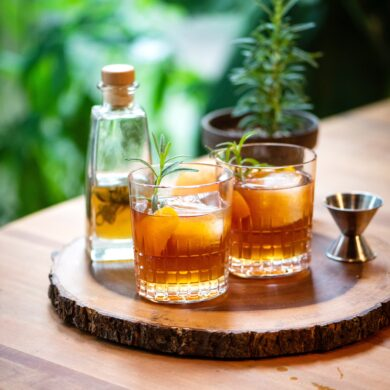 cocktail made with whiskey and infused honey and rosemary simple syrup