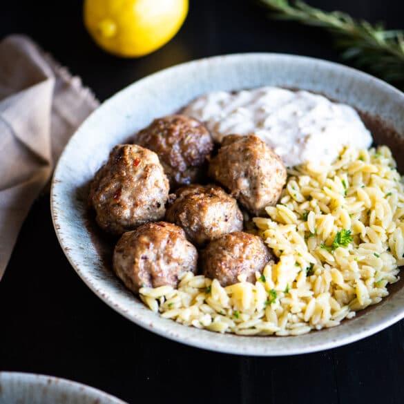bowl of lamb meatballs and orzo pasta