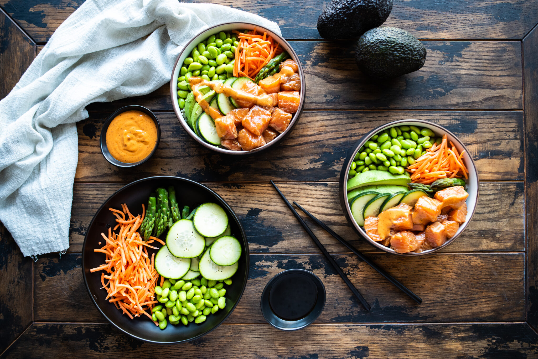 Two poke bowls with additional toppings