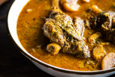 large bowl of curry lamb shanks