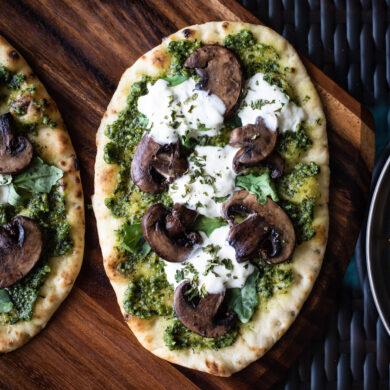 Overhead shot of pesto mushroom flatbread pizza