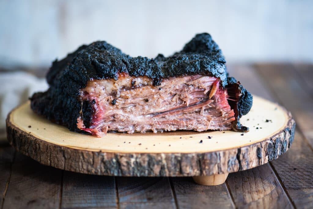 sliced slab of smoked brisket with a dark bark