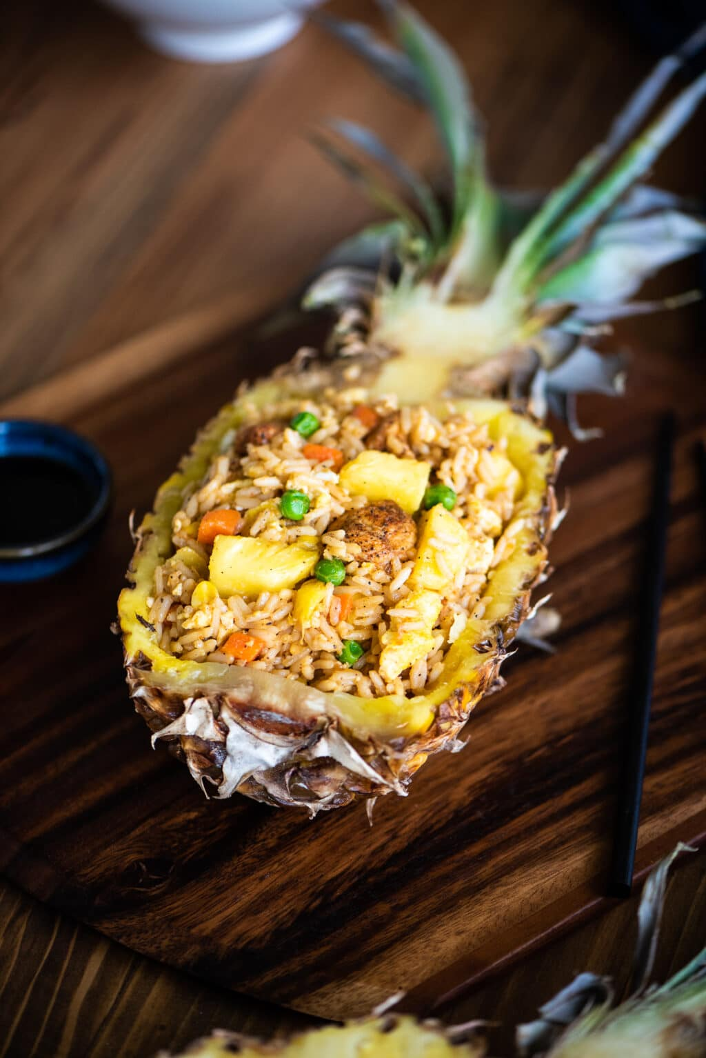 pineapple fried rice served in a pineapple boat