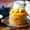 Buttermilk pancake stack topped with caramelized apples