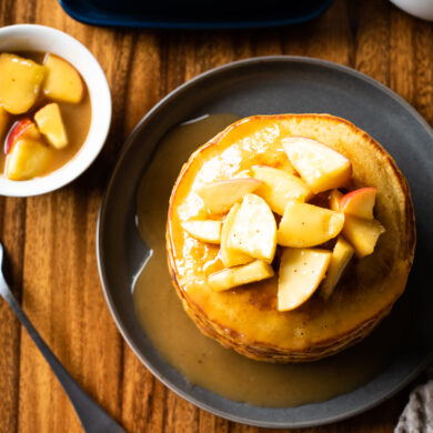 Overhead shot of spiced buttermilk pancakes with caramelized apples