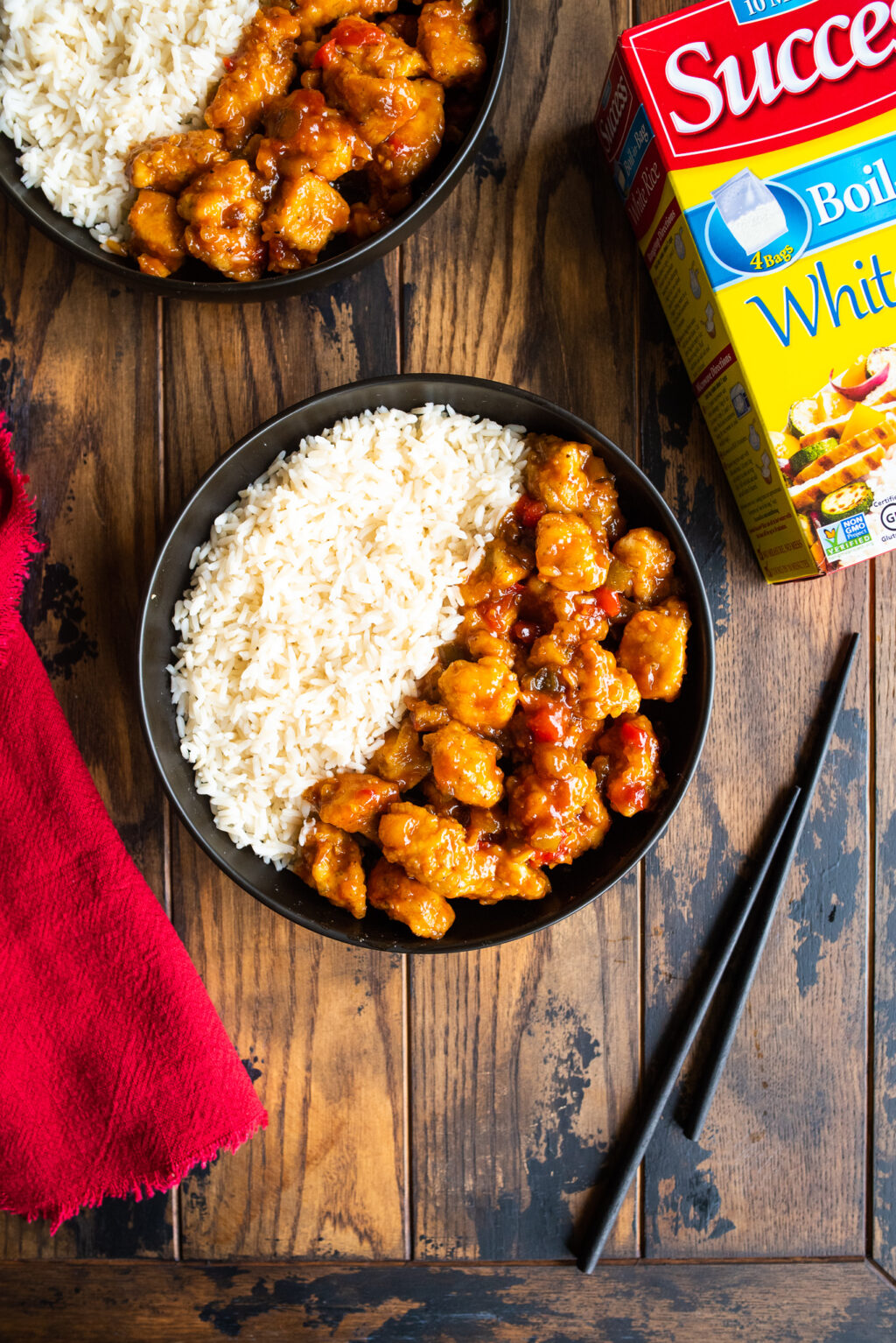 sweet and sour chicken with a box of success rice